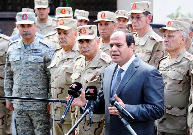 "A handout picture made available by the Egyptian Presidency on April 4, 2015 shows Egyptian President Abdel Fattah al-Sisi (R) giving a statement in Cairo after meeting with the Supreme Council of the Armed Forces. Egypt's president said that securing the Bab al-Mandab access to the Red Sea off Yemen's coast is a top priority, nine days after Cairo joined a Saudi-led offensive against Yemeni Huthi rebels. AFP PHOTO / HO / FADI FARES / EGYPTIAN PRESIDENCY  == RESTRICTED TO EDITORIAL USE MANDATORY CREDIT ""AFP PHOTO / HO / FADI FARES / EGYPTIAN PRESIDENCY"" - NO MARKETING NO ADVERTISING CAMPAIGNS - DISTRIBUTED AS A SERVICE TO CLIENTS =="