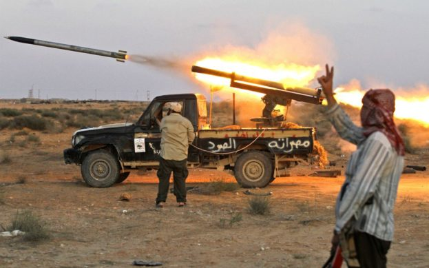 """SIRTE, LIBYA - OCTOBER 12:  A """"Grad"""" rocket is launched from a home-made launcher placed on a Toyota Land Cruiser built in Misrata on October 12, 2011 in Sirte, Libya. Fighting in Libya has ceased following the killing of former leader Muammar Gaddafi and the toppling of his regime. NATO forces used new equipment during the conflict while the Libyan rebel forces utilized whatever technology was made available to them from assisting countries. The Toyota brand vehicles were actively in use particularly the outdated pickup trucks. NATO and National Transitional Council (NTC) are now supporting the collection of the abandoned weapons scattered in the desert and storehouses in Libya to avoid looting, stockpiling and exchange with guerrilla warriors and various terrorists groups from other struggling nations.  (Photo by John Cantlie/Getty Images)"""