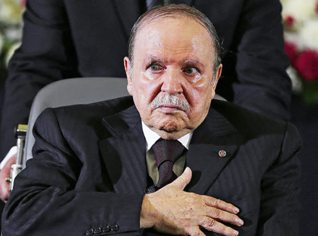 epa04183737 Algerian President Abdelaziz Bouteflika, re-elected for a fourth mandate, during the oath of office in Algiers, Algeria, 28 April 2014. Bouteflika was sworn in for a fourth term in a wheelchair. Bouteflika, who was reelected in April 17 elections, appeared stronger than in recent appearances but still fatigued as he took the oath of office in a televised ceremony at the Palais des Nations convention centre. The 77-year-old leader's quest for another five years in office, despite being too weak to campaign after suffering a stroke last year, had divided Africa's biggest gas producer.  EPA/MOHAMED MESSARA
