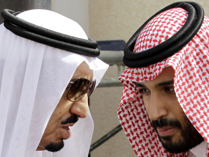 FILE - In this Monday, May 14, 2012 file  photo, then Crown Prince Salman, left, speaks with his son Prince Mohammed bin Salman as they wait for Gulf Arab leaders ahead of the opening of a Gulf Cooperation Council summit, in Riyadh, Saudi Arabia. On Wednesday, April 29, 2015, Prince Mohammed was appointed deputy crown prince, placing him second in line for the crown. He is believed to be around 30 years old, and as defense minister has assumed a leading role in the Saudi-led air campaign against Shiite rebels in Yemen. (AP Photo/Hassan Ammar, File)